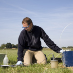 Environmental Scientist Taking samples of the soil and groundwater, groundwater sampling, pollution testing