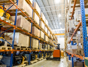 Modern warehouse / distribution center with forklifts, material handling equipment. pick line. racking, batteries.